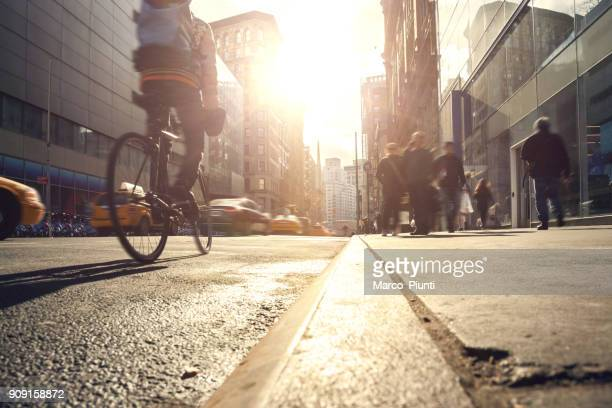 manhattan motion blurred rush hour - bicycle stock pictures, royalty-free photos & images