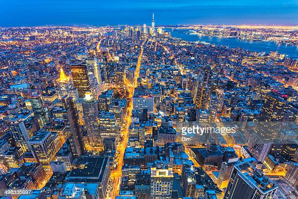 manhattan, new york, aerial view at night - midtown manhattan stock pictures, royalty-free photos & images