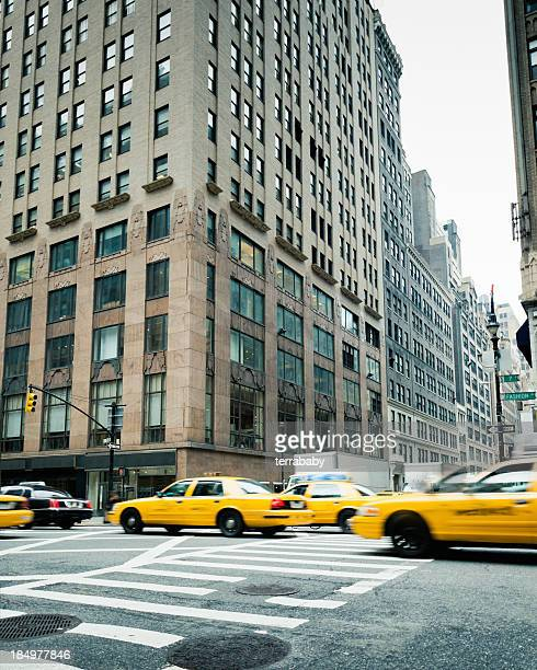 manhattan new york city cabs on fashion avenue - 7th avenue stock pictures, royalty-free photos & images