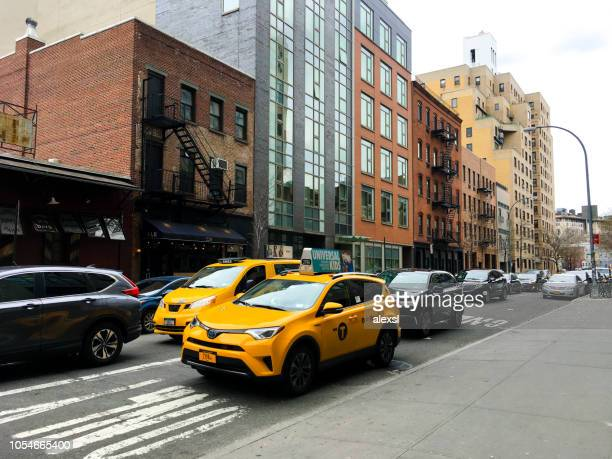 Manhattan New York City SoHo street traffic yellow taxi cabs