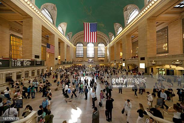 manhattan new york city waiting commuters at grand central station - grand central station manhattan stock pictures, royalty-free photos & images