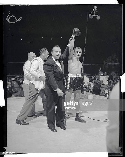 Manhattan New York New York Carlos Ortiz stops Kenny Lane for junior welterweight championship Photo shows announcer Johnny Addie holds up Carlos...