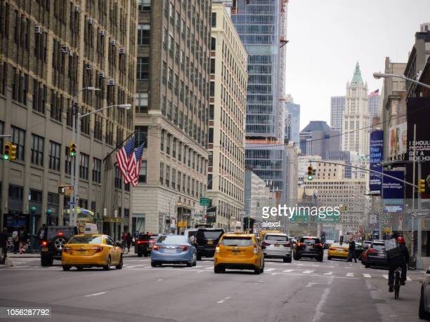 Manhattan New York street traffic yellow taxi cabs