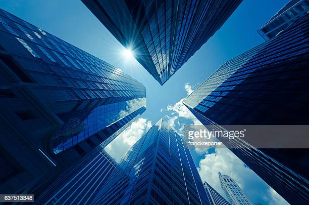 manhattan office building from below - built structure stock pictures, royalty-free photos & images