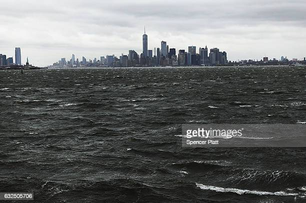 Manhattan sits under heavy cloud cover as the city prepares for a nor'easter storm on January 23 2017 in New York City The storm is expected to bring...