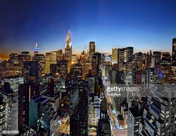 manhattan skyline at night - anatoleya stock pictures, royalty-free photos & images
