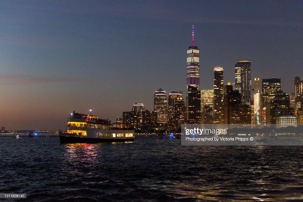 Manhattan skyline at night viewed from the water : Stock Photo