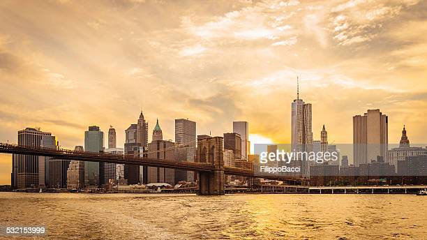 manhattan skyline at sunset - wall street lower manhattan stock pictures, royalty-free photos & images