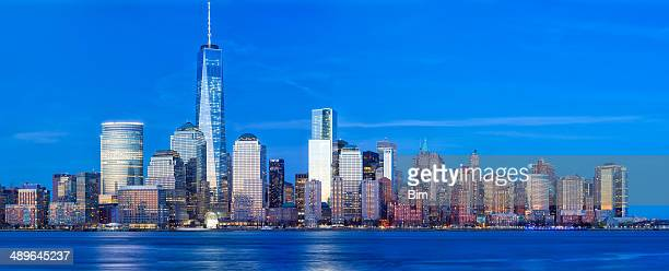 manhattan skyline & freedom tower at dusk, new york city - lower manhattan stock photos and pictures