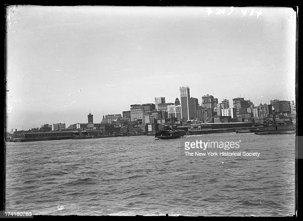 Manhattan skyline from the East River showing 60 Wall Street and piers New York New York late 19th or early 20th century