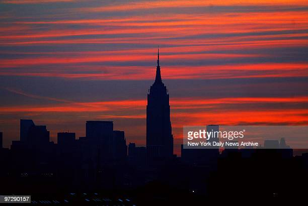 Manhattan skyline is dark as the sun comes up on the morning after a massive power failure caused the largest power outage in the nation's history...