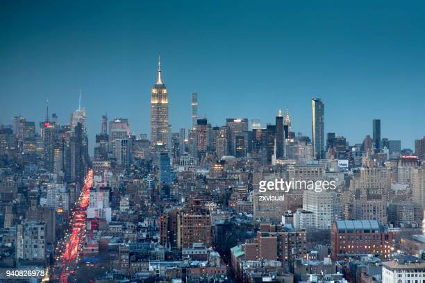 manhattan skyline view at dusk - sixth avenue stock pictures, royalty-free photos & images