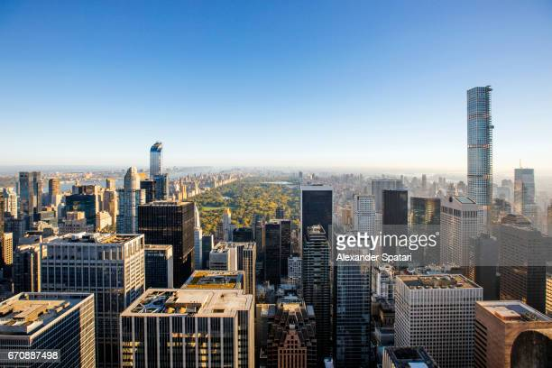 Manhattan skyline with Central Park in the center on a sunny day, New York, United States