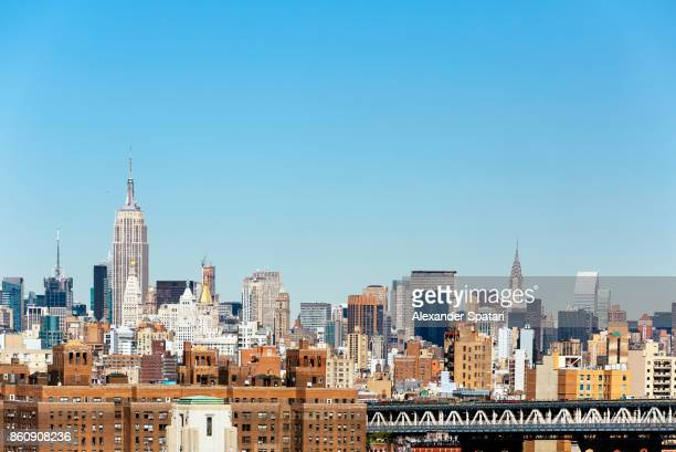 manhattan skyline with empire state building and chrysler building, new york city, usa - 澄んだ空 ストックフォトと画像