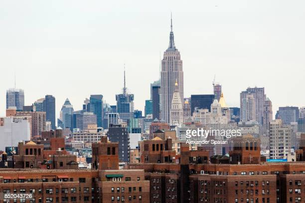 Manhattan skyline with Lower East Side on foreground and Empire State Building in the background