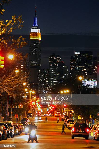 CONTENT] Manhattan skyline with the Empire State Building after night fall from Sunnyside Queens People scour about to get home to work and other...