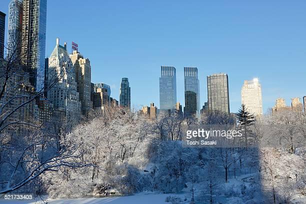 Manhattan skyscraper from snowy Central Park