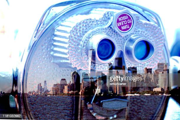 manhattan skyscrapers and coin operated binoculars. - magazine cover stock pictures, royalty-free photos & images