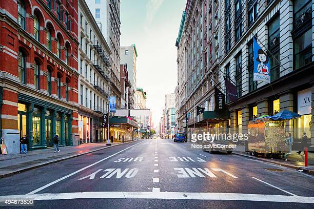manhattan soho broadway looking north early morning - broadway manhattan stock photos and pictures