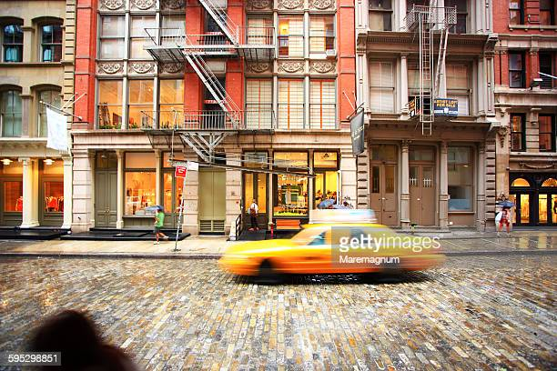 manhattan, soho, mercer street, a taxi - soho new york stock pictures, royalty-free photos & images