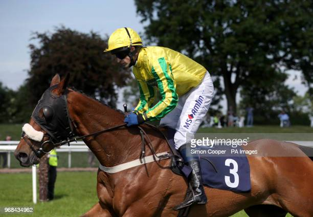 Manhattan Spring ridden by Andrew Thornton in action during The Mercia Power Response Novices Hurdle at Uttoxeter Racecourse