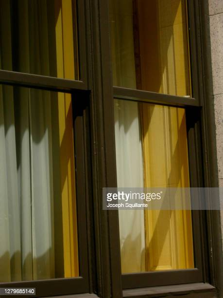 manhattan street window with curtain - joseph squillante stock pictures, royalty-free photos & images
