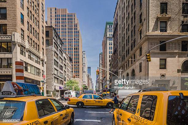 manhattan, taxis in madison avenue - yellow taxi stock pictures, royalty-free photos & images