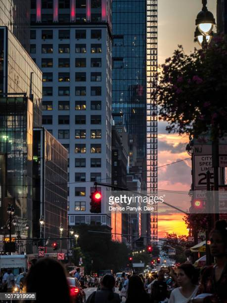 manhattanhenge july 2018 - panyik-dale stock photos and pictures