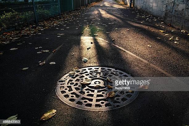 Manhole and Path of dusk