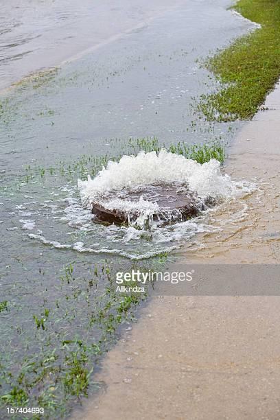 manhole cover bubbles over vert