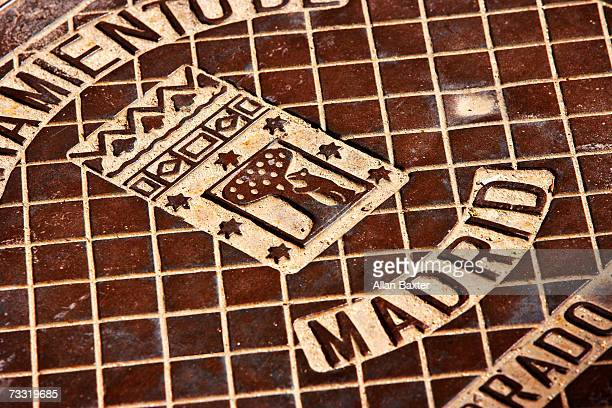 Manhole cover with symbol of Madrid