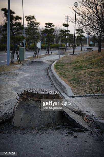 Manholes poke out from the ground due to the liquefaction triggered by the 90 magnitude earthquake on March 19 2011 in Urayasu Chiba Japan The...