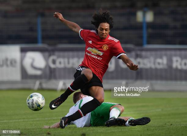 Mani Bughail Mellor of Manchester United and Cormac Lawlor of Northern Ireland during the NI Super Cup game between Manchester United u18s and...