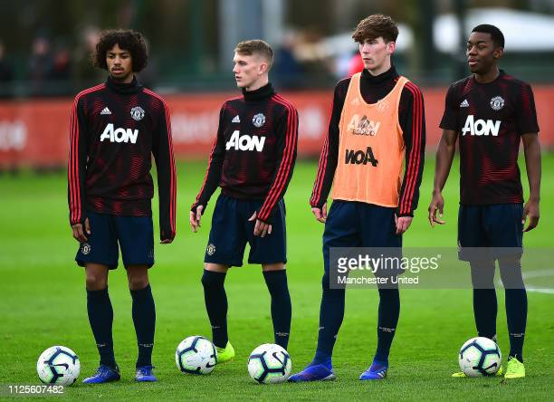 Mani BughailMellor Ethan Galbraith James Garner and Anthony Elanga of Manchester United U18s warm up ahead of the U18 Premier League Cup Quarter...