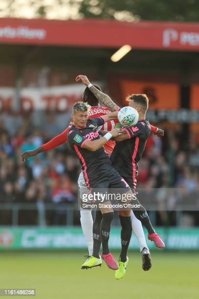 Mani Dieseruvwe of Salford battles with Ezgjan Alioski of Leeds and Ben White of Leeds during the Carabao Cup First Round match between Salford City...