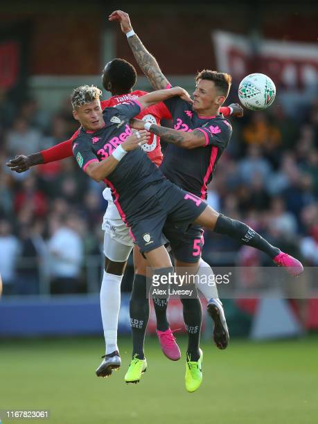 Mani Dieseruvwe of Salford City is challenged by Ezgjan Alioski and Ben White of Leeds United during the Carabao Cup First Round match between...