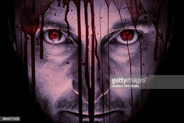 maniac male face against a blood-stained window - crime and murder stock pictures, royalty-free photos & images