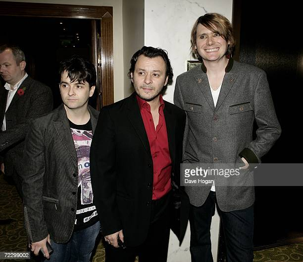 Manic Street Preachers members Sean Moore, James Dean Bradfield and Nicky Wire arrive at the Q Awards 2006 at Grosvenor House Hotel on October 30,...