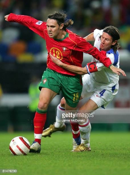 Maniche of Portugal is tackled by Alexiy Smertin of Russia during the World Cup Group 3 match between Portugal and Russia on October 13 2004 at the...