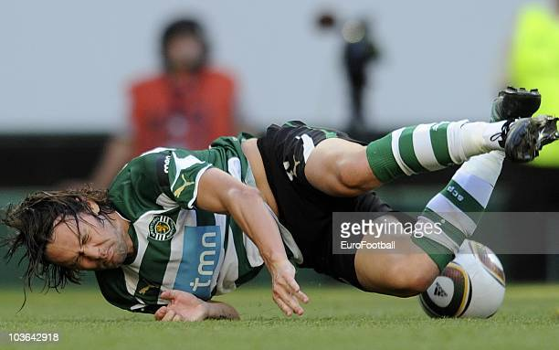 Maniche Ribeiro of Sporting Lisbon is tackled during the Portuguese Liga football match between Sporting Lisbon and Maritimo at Alvalade Stadium on...