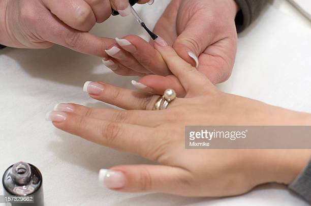 manicure making - french manicure stock photos and pictures