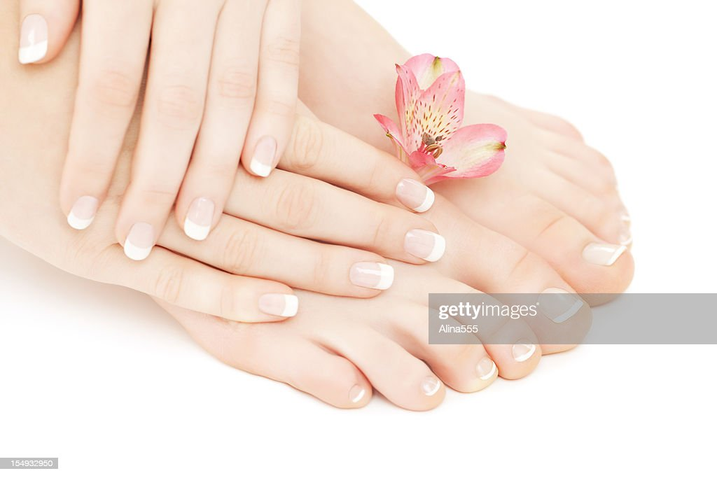 Manicure- pedicure: beautiful female hands and feet : Stock Photo