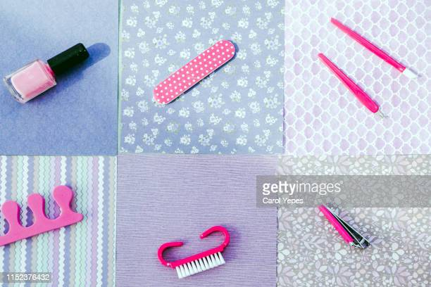manicure set in violet and pink abstract background - nail scissors stock pictures, royalty-free photos & images