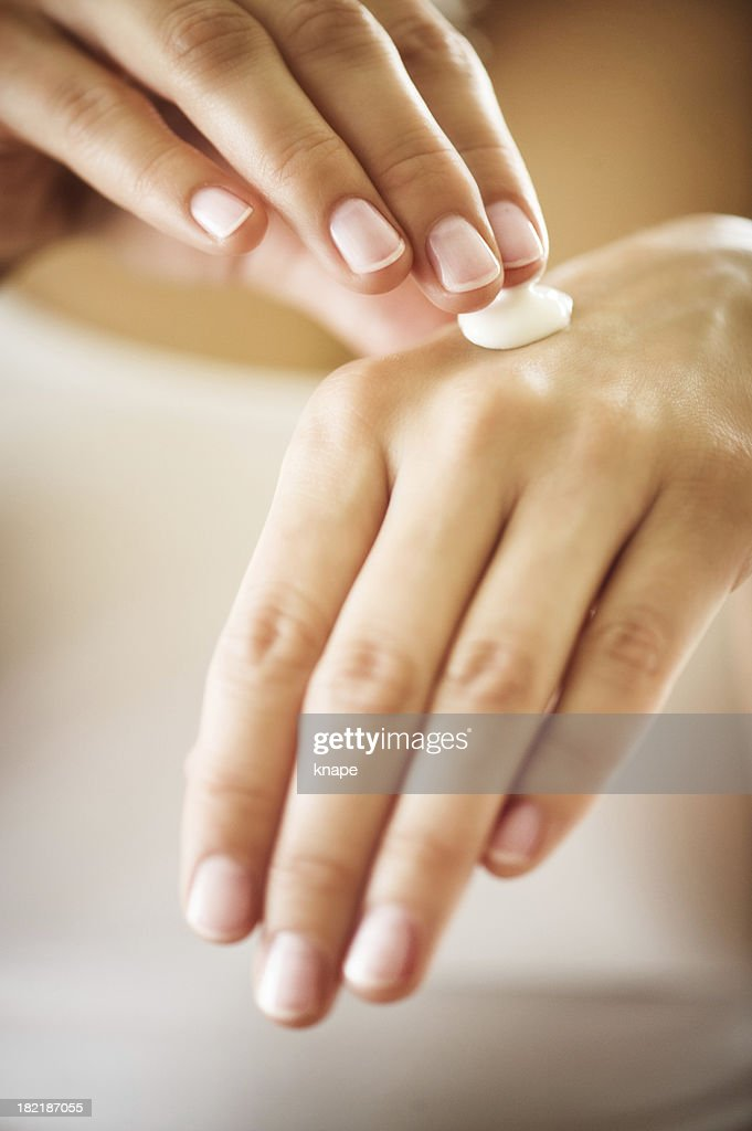 manicured hands with moisturizer : Stock Photo