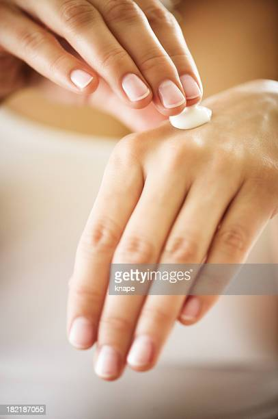 manicured hands with moisturizer