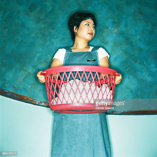 Manicurist Carrying Laundry Basket
