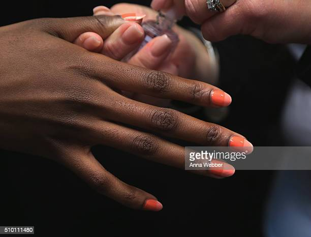 Manicurists backstage design models' nails with essie polishes for Rebecca Minkoff Spring 2016 on February 13 2016 in New York City