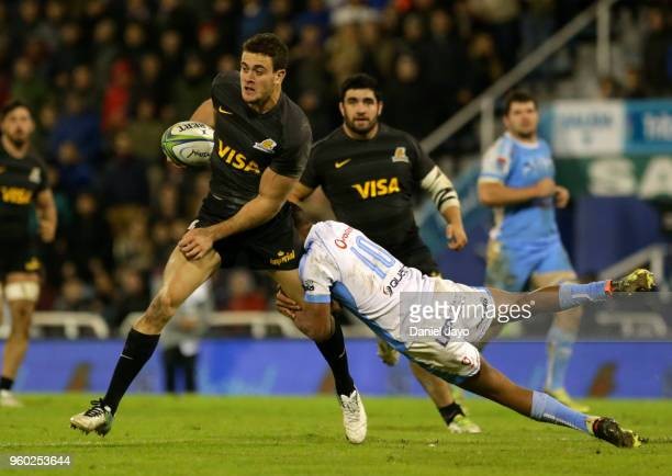 Manie Libbok of Bulls tackles Julian Montoya of Jaguares during a match between Jaguares and Bulls as part of Super Rugby 2018 at Estadio Jose...