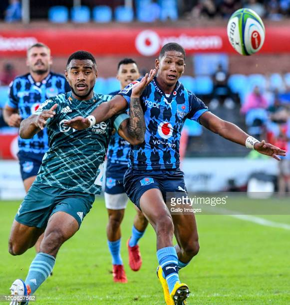 Manie Libbok of the Bulls jostles for ball possession with Jona Nareki of the Highlanders during the Super Rugby match between Vodacom Bulls and...