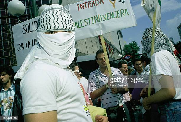 Manifestation against the racism People withbanner in favor of the Palestinian Intifada during the manifestation against the racism in Madrid